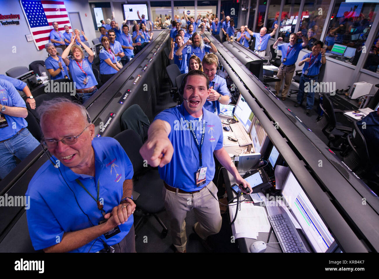 The Mars Science Laboratory (MSL) team in the MSL Mission Support Area reacts after learning the the Curiosity rover - Stock Image
