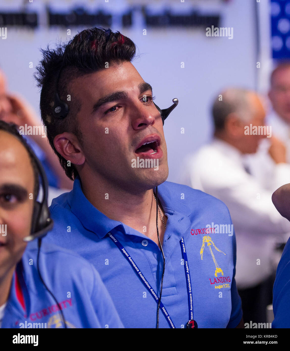 Mars Science Laboratory (MSL) Systems Engineer Bobak Ferdowsi is seen reacting after the MSL rover Curiosity successfully - Stock Image