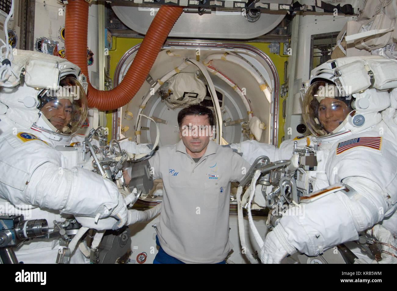 ISS-33 American EVA 00 Akihiko Hoshide, Yuri Malenchenko and Sunita Williams - Stock Image