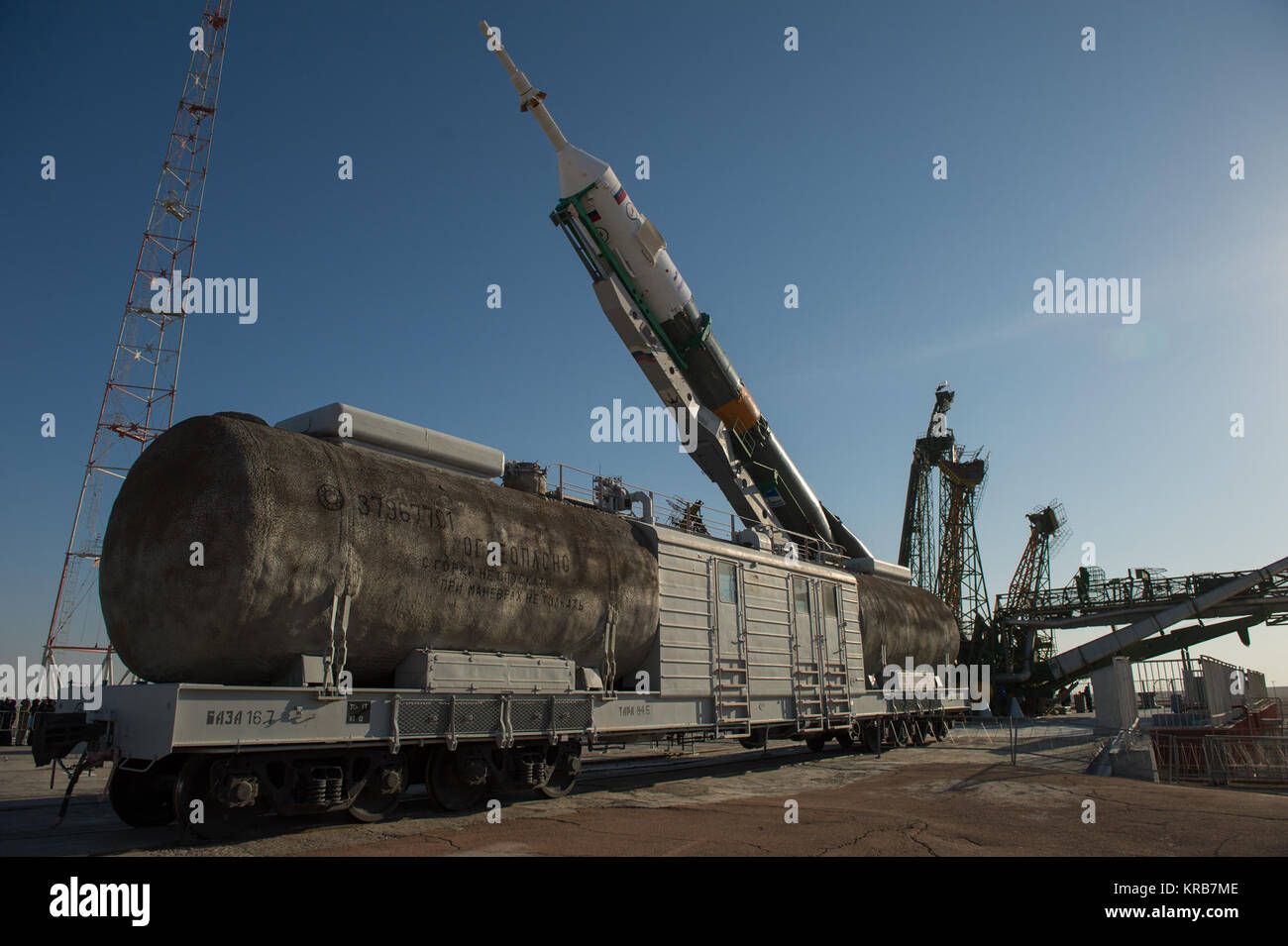 The Soyuz rocket is erected into position after being rolled out to the launch pad by train on Tuesday, March 26, - Stock Image