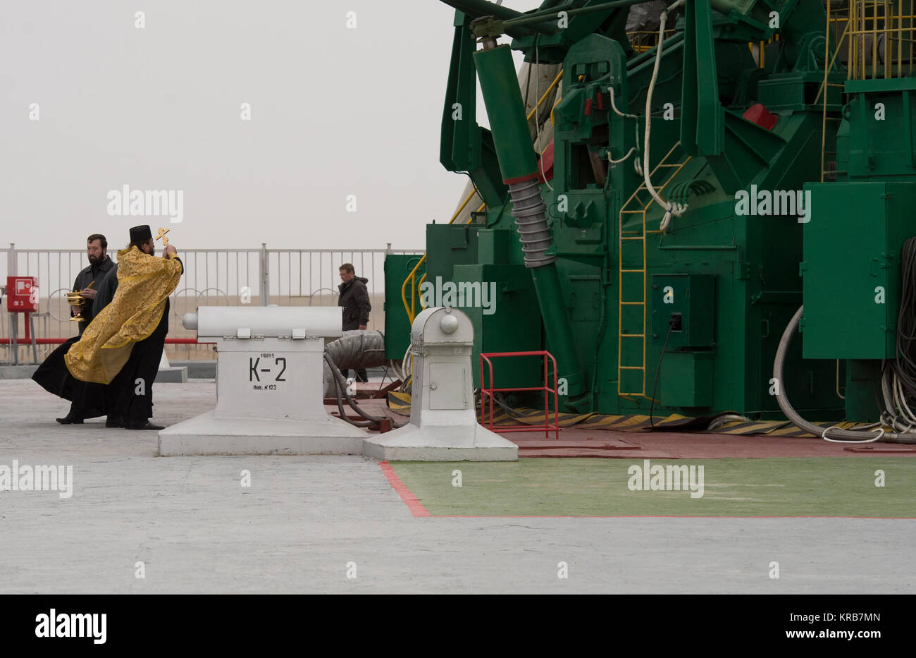 An Orthodox priest blesses the Soyuz rocket at the Baikonur Cosmodrome launch pad on Wednesday, March 27, 2013 in - Stock Image