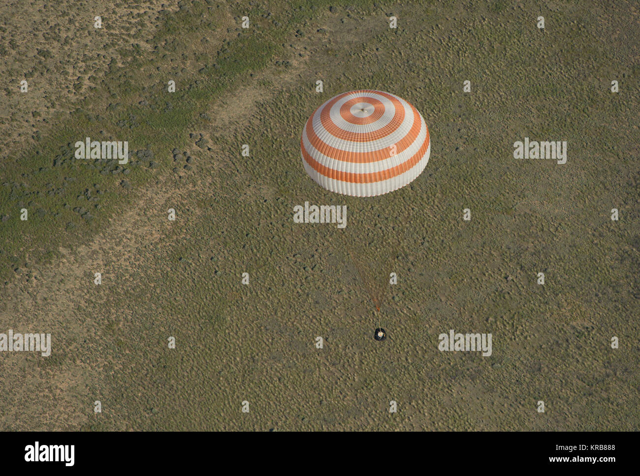 The Soyuz TMA-07M spacecraft is seen as it lands with Expedition 35 Commander Chris Hadfield of the Canadian Space - Stock Image