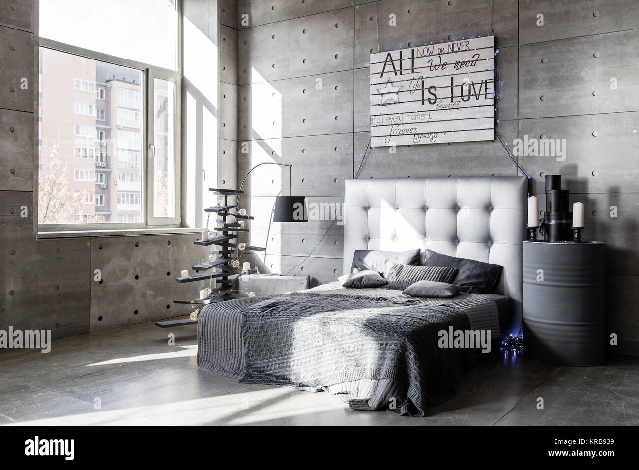 Modern empty bedroom in loft style with grey colors and wooden hand ...