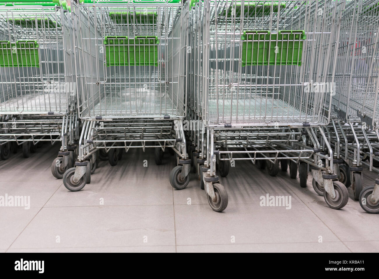 Shopping carts in a supermarket, detail of metal carts in a supermarket, - Stock Image
