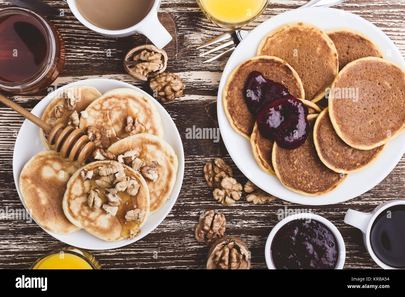 Pumpkin and buttermilk pancakes breakfast or brunch. Homemade   pancakes with berry jam, walnuts and honey, orange - Stock Image