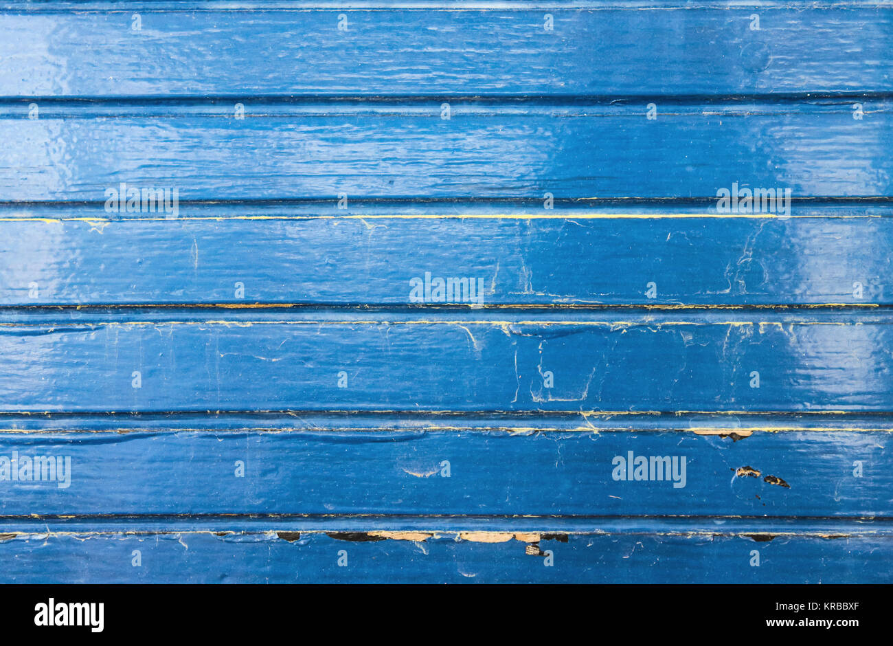 Grunge Blue Painted Wood from Wooden Boat Background with cracks and scrapes and water stains - Stock Image