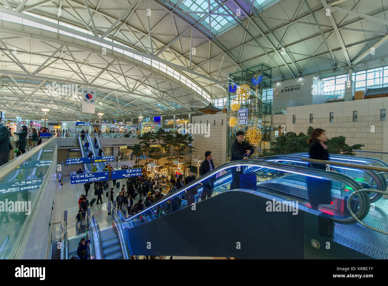 Dec 9,2017 escalator to connect departure and arrival area at  Incheon Airport departure area,Incheon , Korea - Stock Image