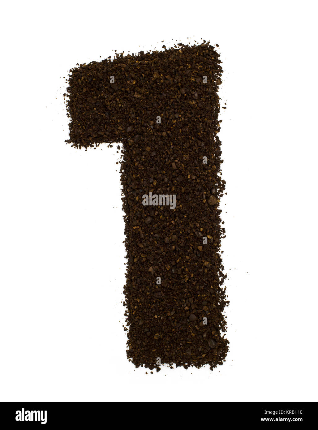 Number 1 one made of ground coarse coffee isolated on white. Flat lay, top view - Stock Image