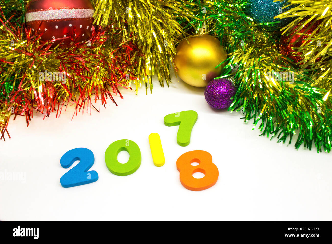 2018 happy new year tinsel and Christmas balls decoration background - Stock Image