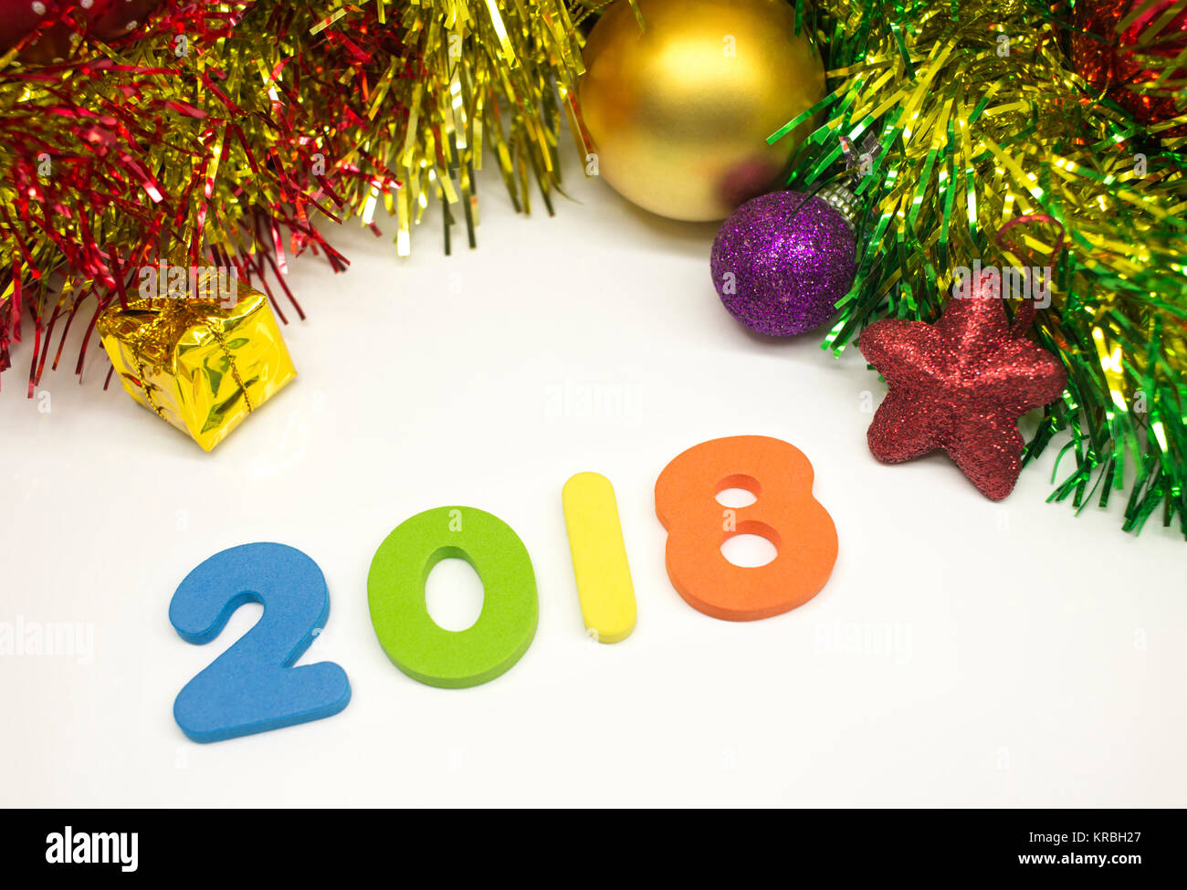 Happy New Year 2018 colourful tinsel Christmas decoration background - Stock Image