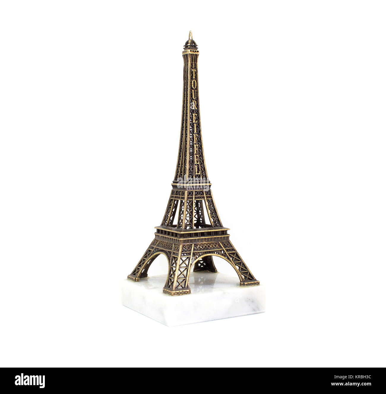 Paris Eiffel tower souvenir on the stand isolated on white background - Stock Image