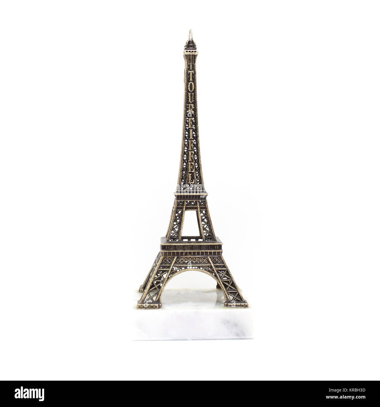 Paris Eiffel tower miniature on the marble stand isolated on white background Stock Photo