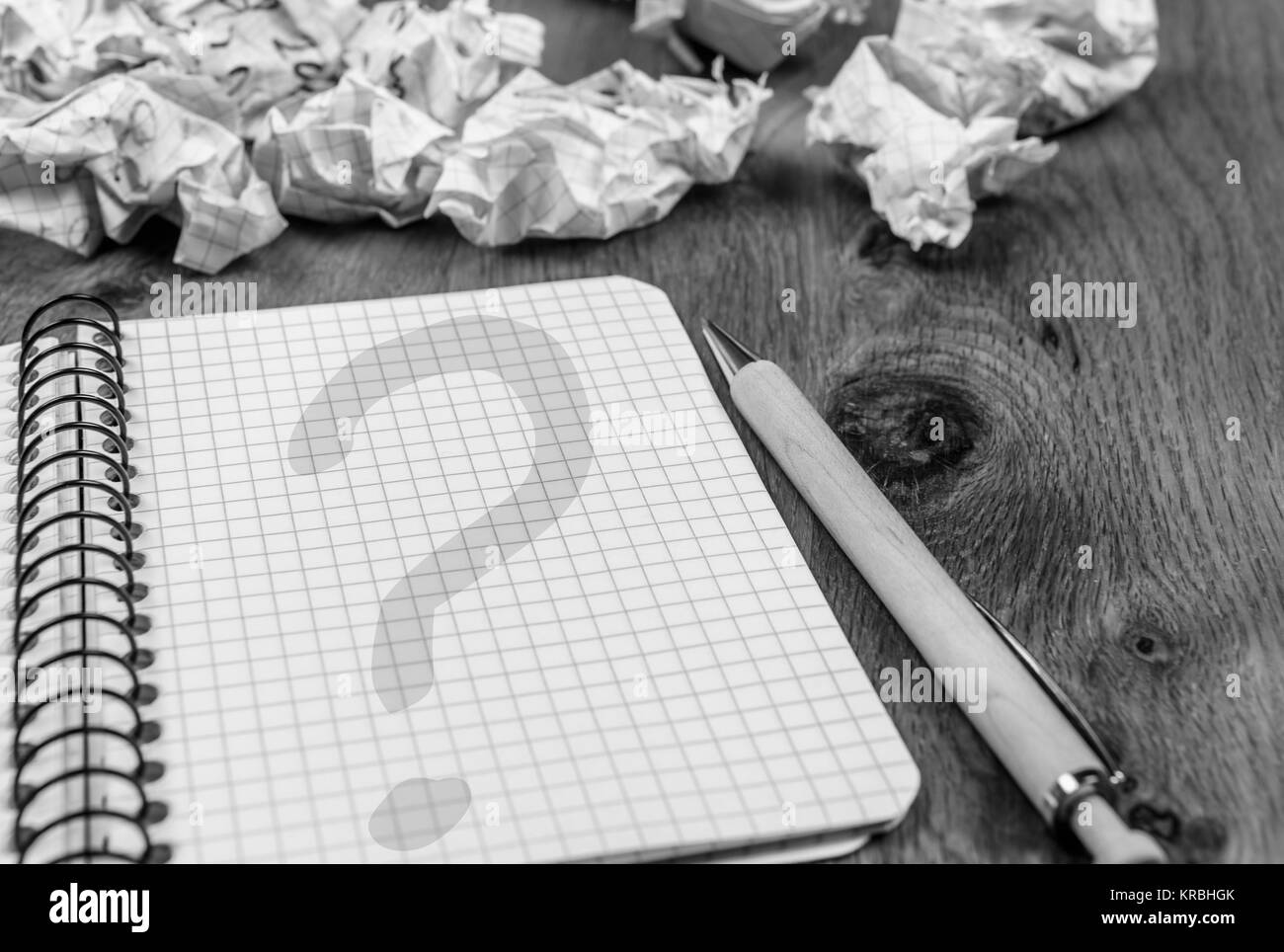 Question mark on notebook page - Stock Image