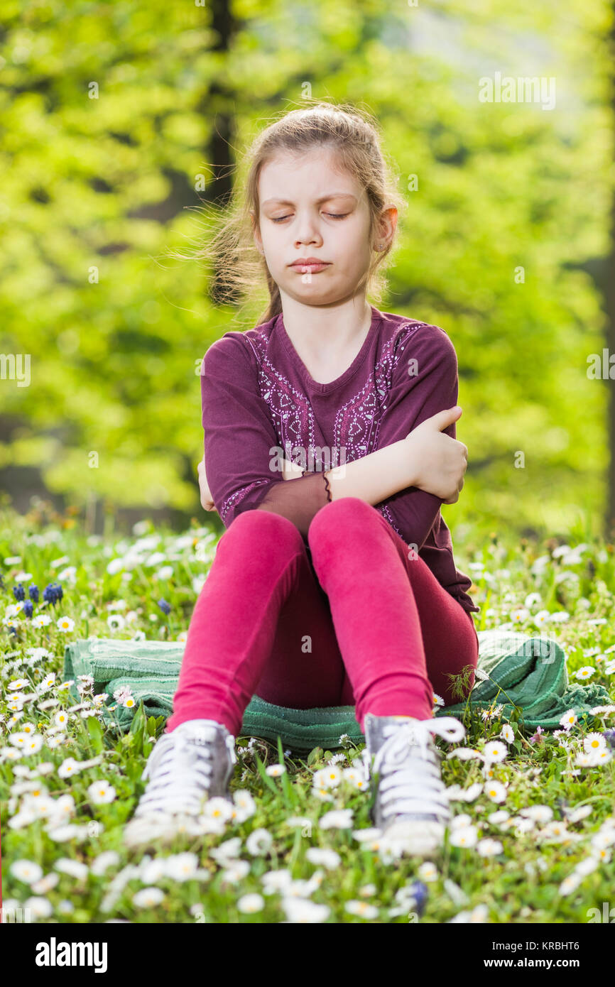 Portrait of angry child in park - Stock Image