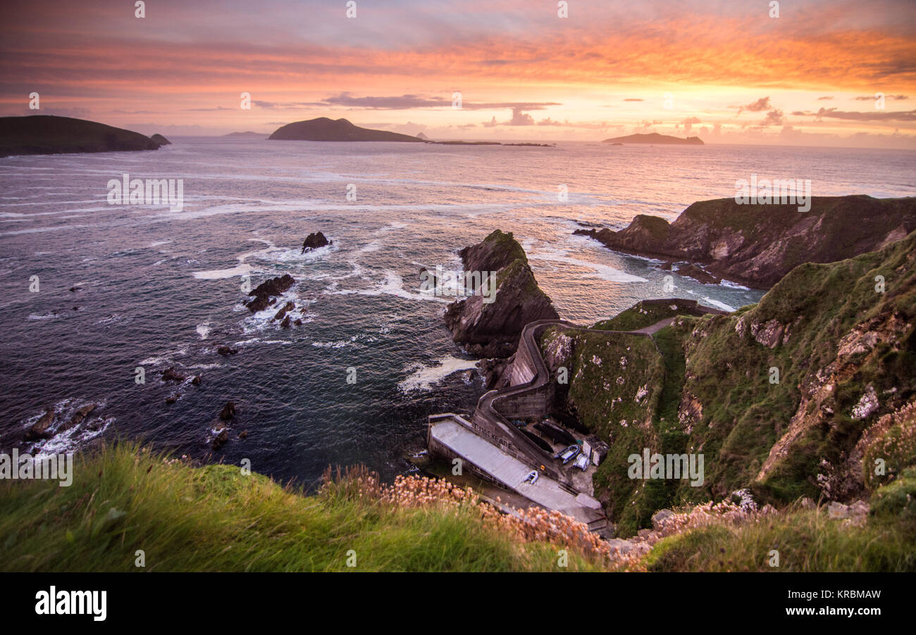 Sunset over Dunquin Pier and the Blasket Islands on the rocky Atlantic coast of Dingle Peninsula in Ireland's County Stock Photo