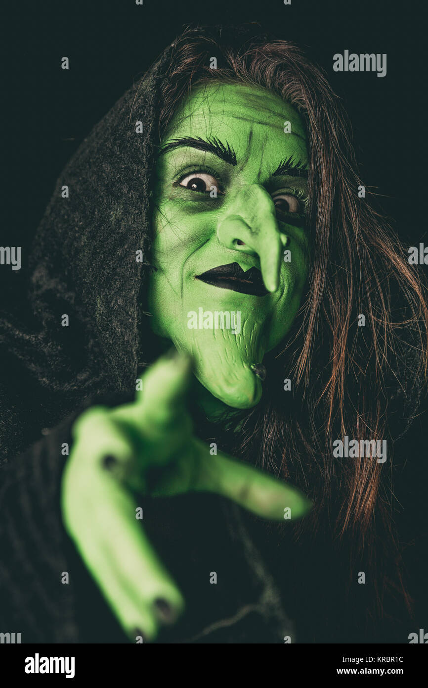Evil Witch Woman Casting Spell Stock Photos & Evil Witch Woman
