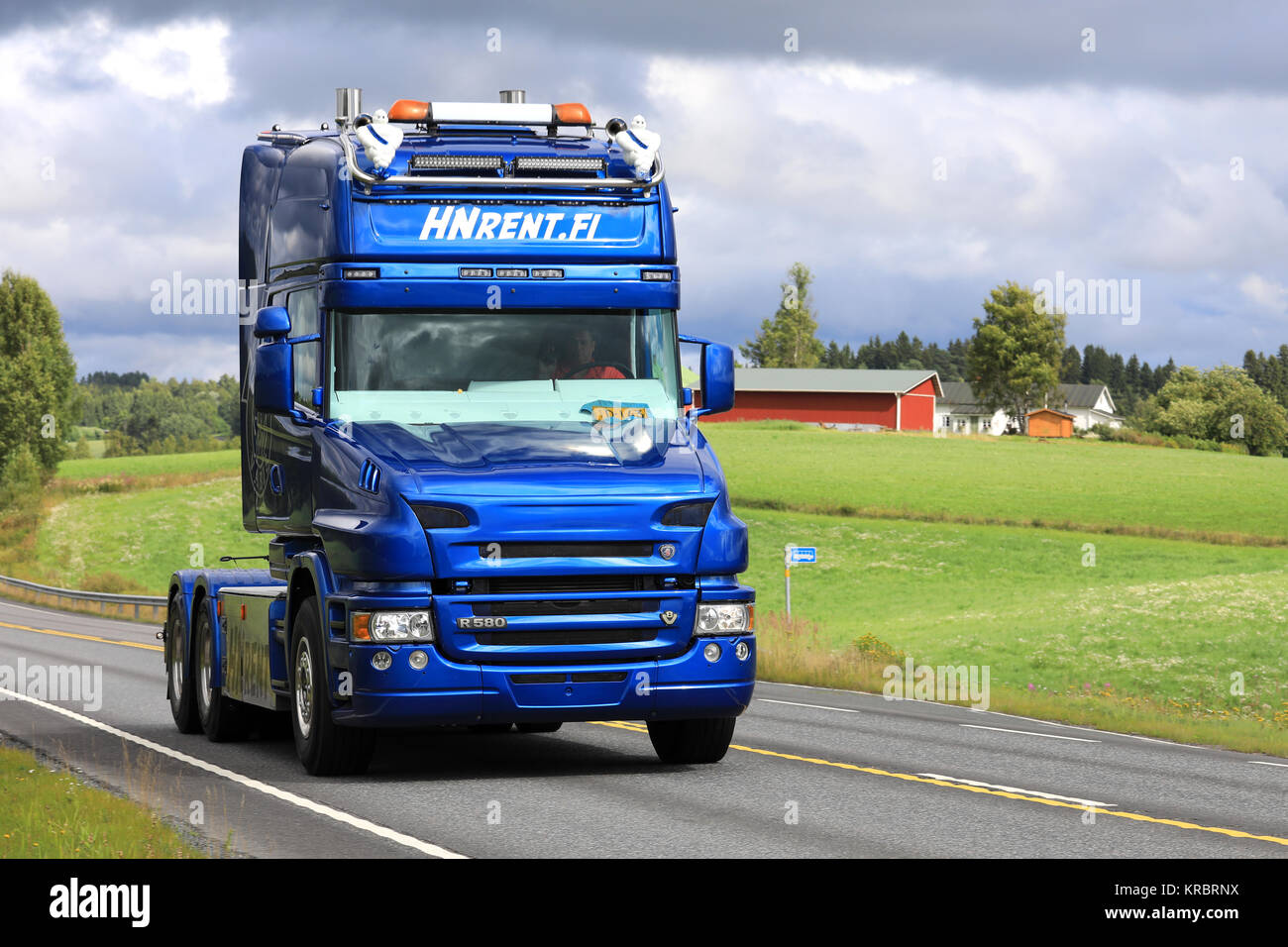IKAALINEN, FINLAND - AUGUST 13, 2017: Blue Scania R580 truck with conventional cab of HN Rent.fi moves along highway - Stock Image
