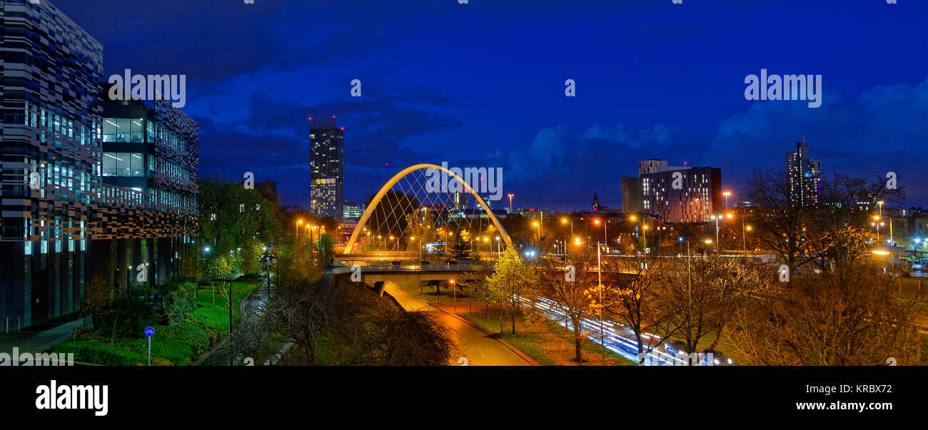 Manchester skyline from south with Hulme Arch featuring and part of Manchester Metropolitan University on left. - Stock Image