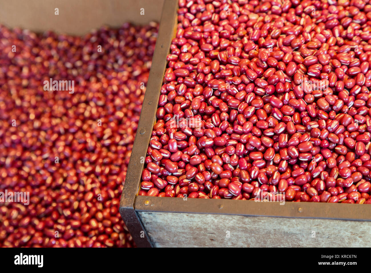 red kidney beans raw in the wooden box ready to sell on the market. organic grains food, Japanese calls Adzuki or - Stock Image