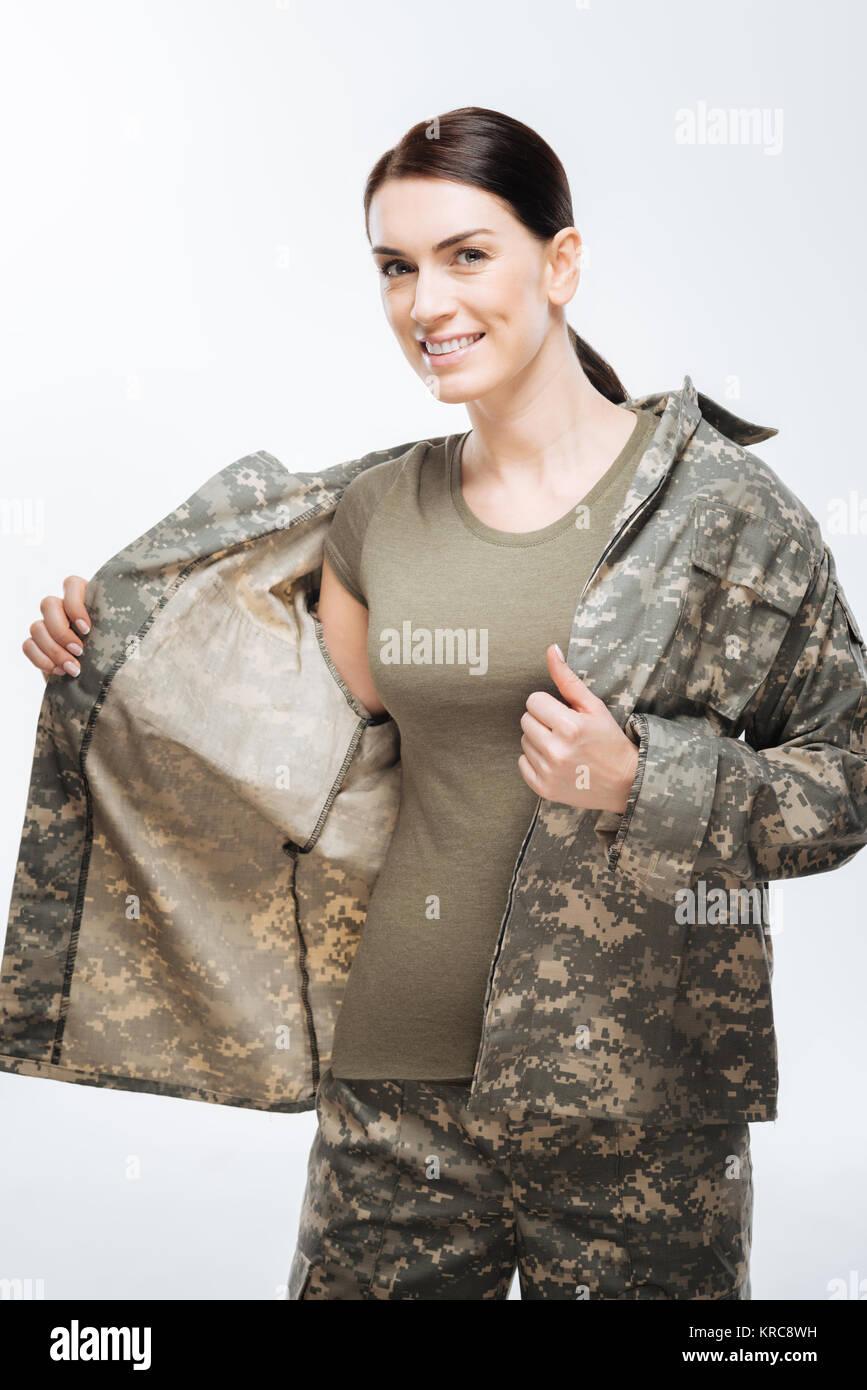 Happy glad woman wearing camouflage jacket - Stock Image