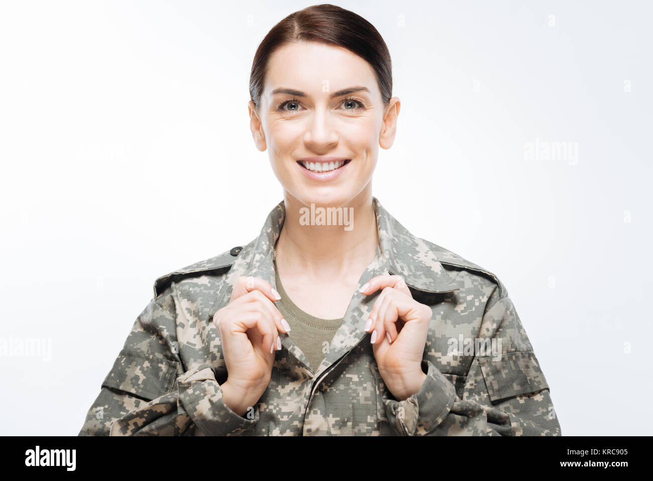 Nice pretty woman smiling in military uniform  - Stock Image