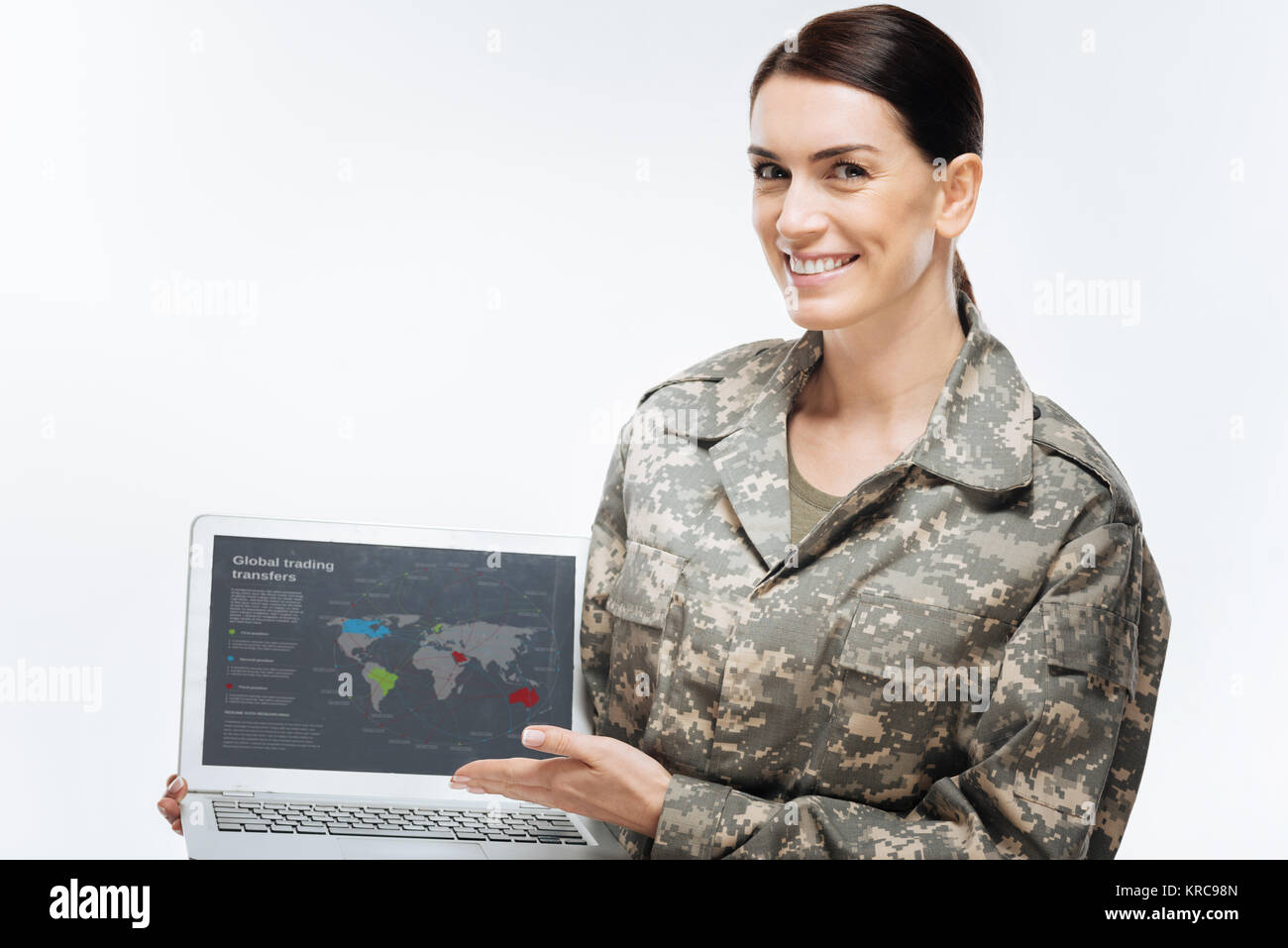 Vigorous female soldier mapping region - Stock Image
