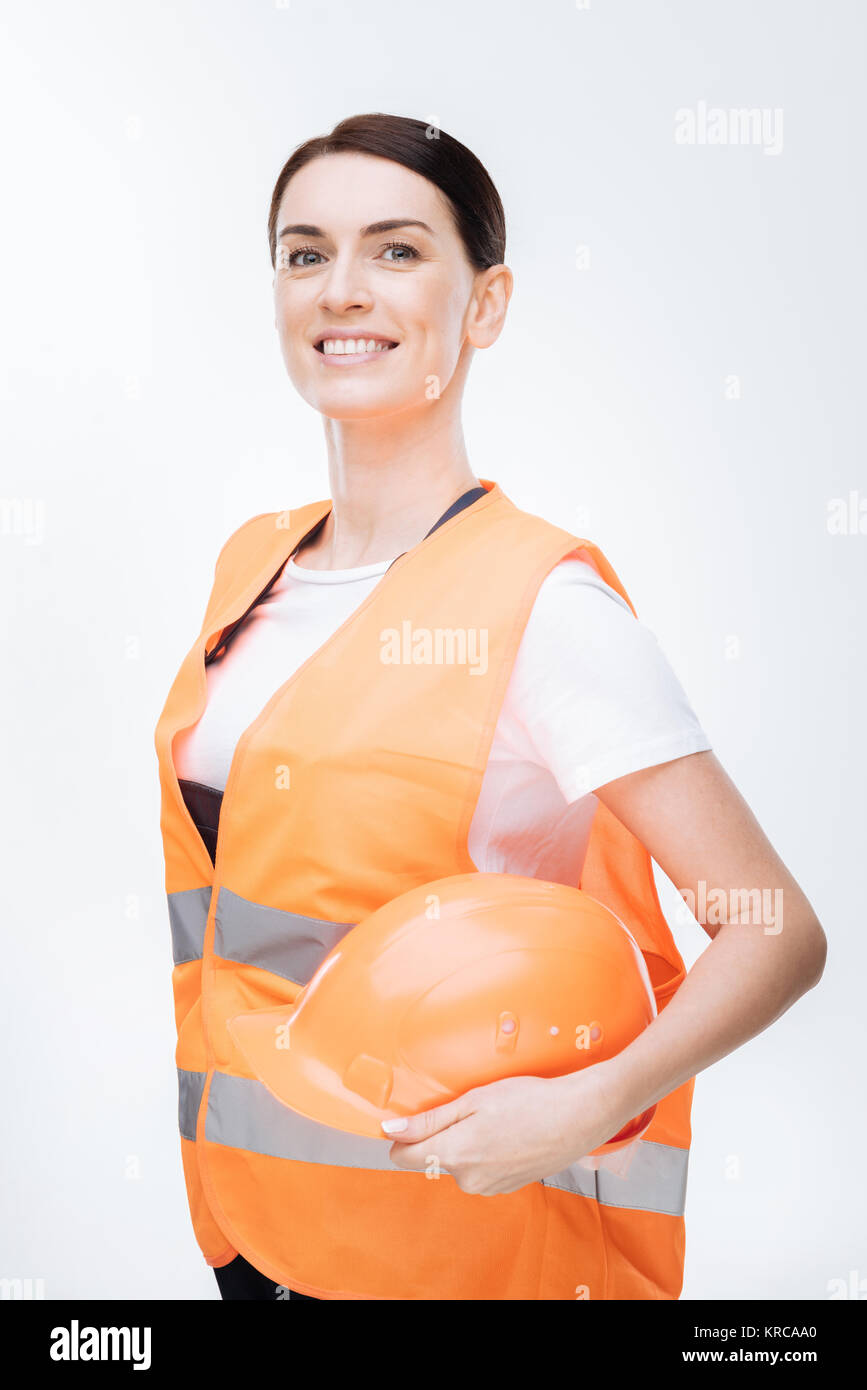 Adorable female worker posing in uniform Stock Photo