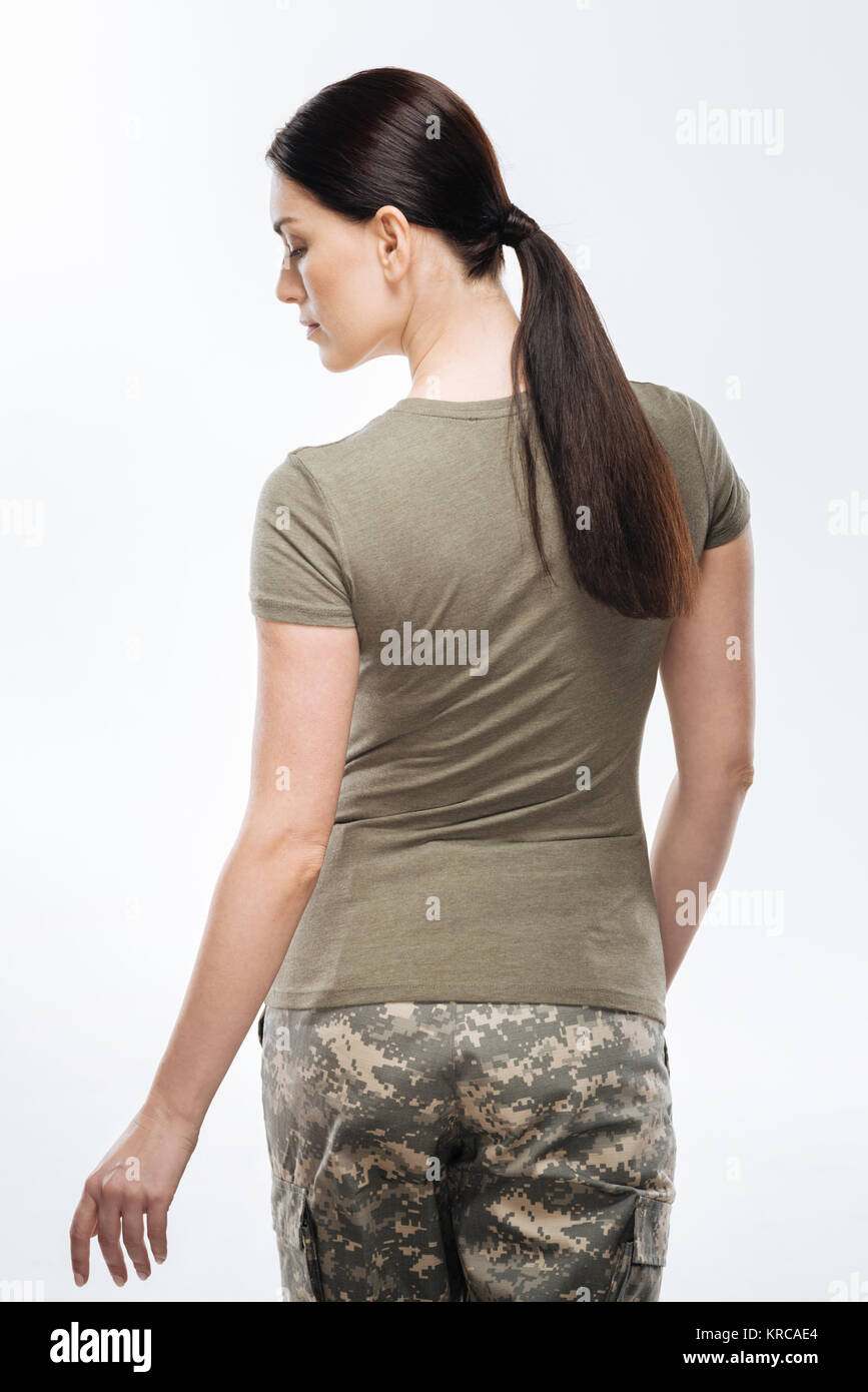 Brunette female soldier  saying goodbye - Stock Image