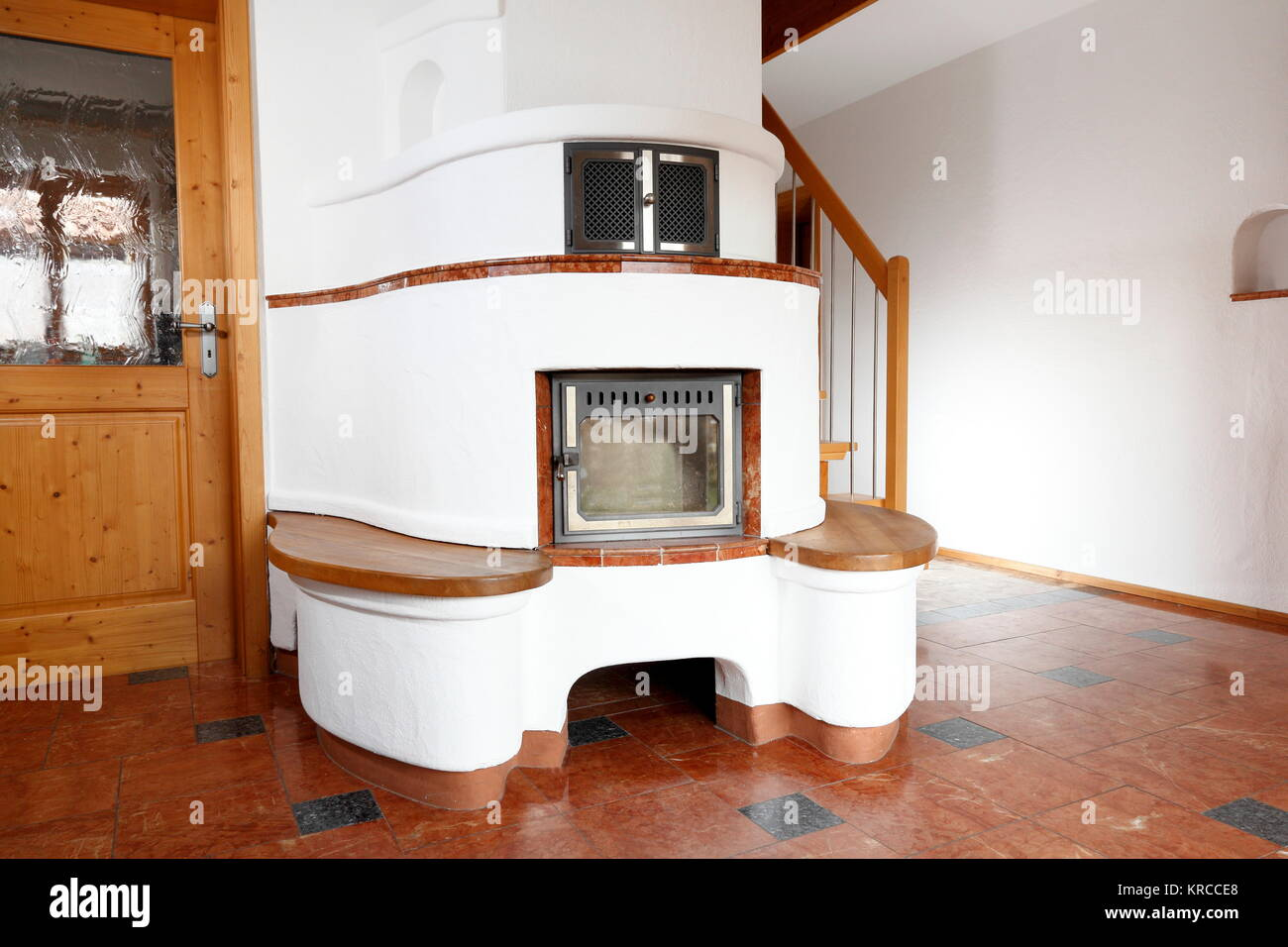 round wood stove in the room - Stock Image