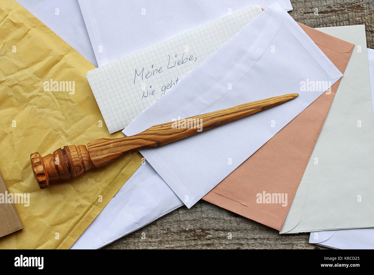 a letter opener in wood and open mail. letters received Stock Photo