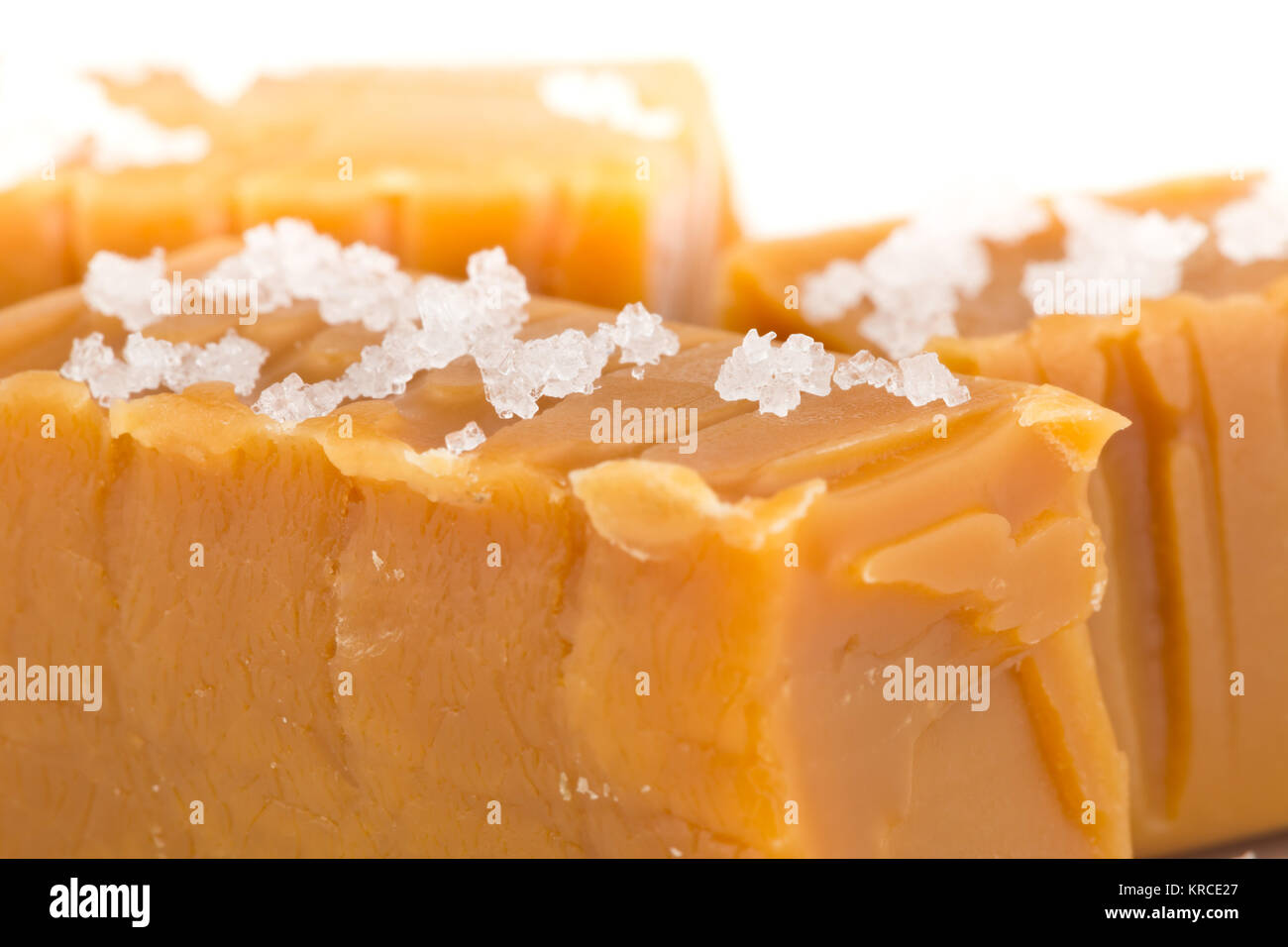 Hand made caramel toffee pieces with sea salt macro with selective focus - Stock Image
