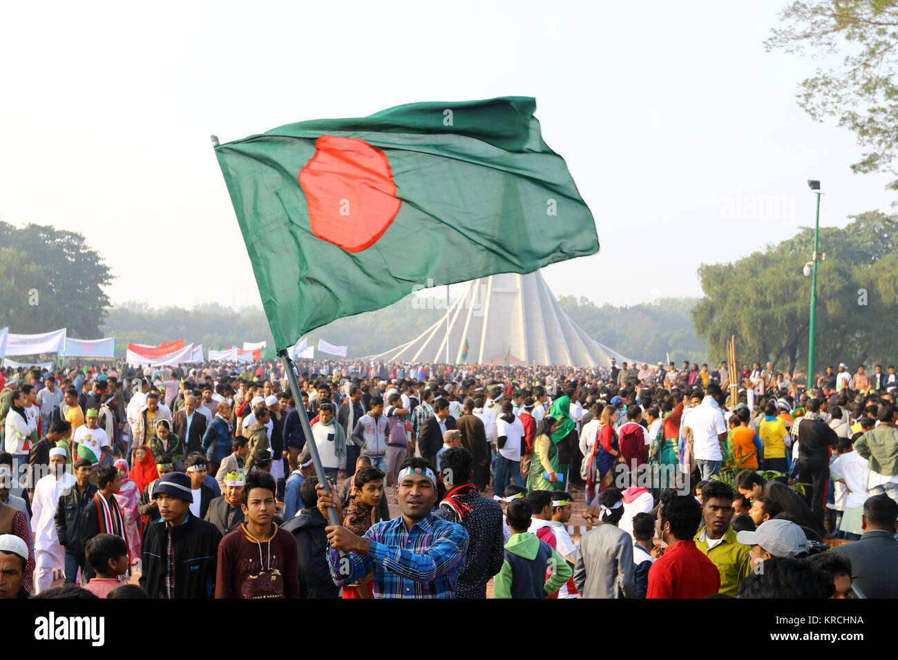 Bangladeshi people throng National Mausoleum in Savar, on the outskirts of Dhaka, to pay tributes to the martyrs Stock Photo