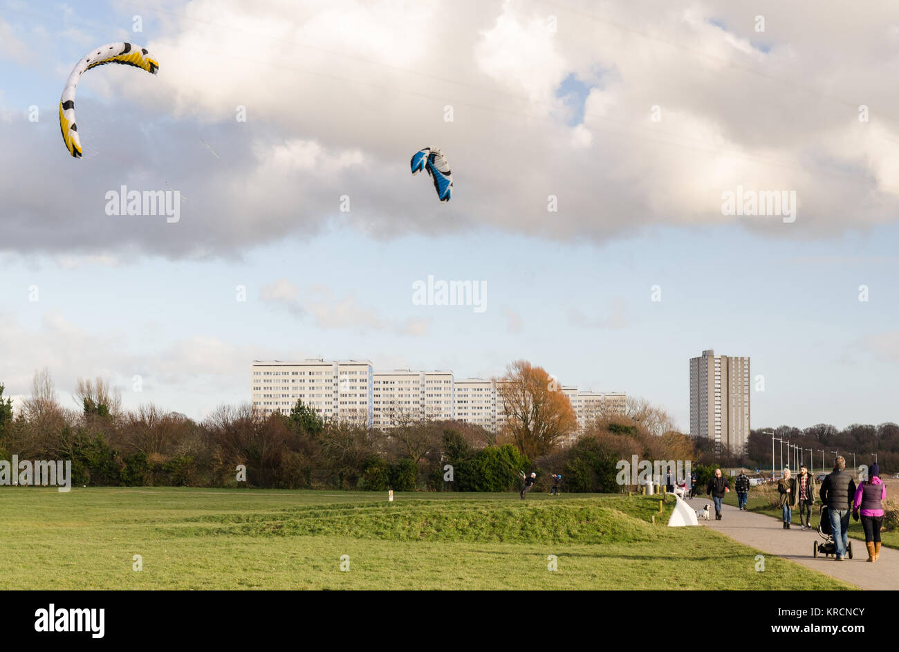 Southampton, England, UK - February 16, 2014: People participate in kite landboarding on a sunny day in a park at Stock Photo