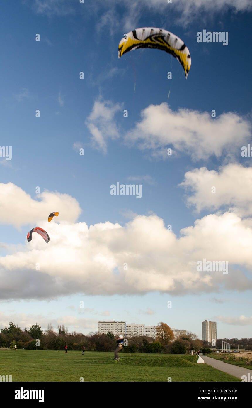 Southampton, England, UK - February 16, 2014: People participate in kite landboarding on a sunny day in a park at - Stock Image