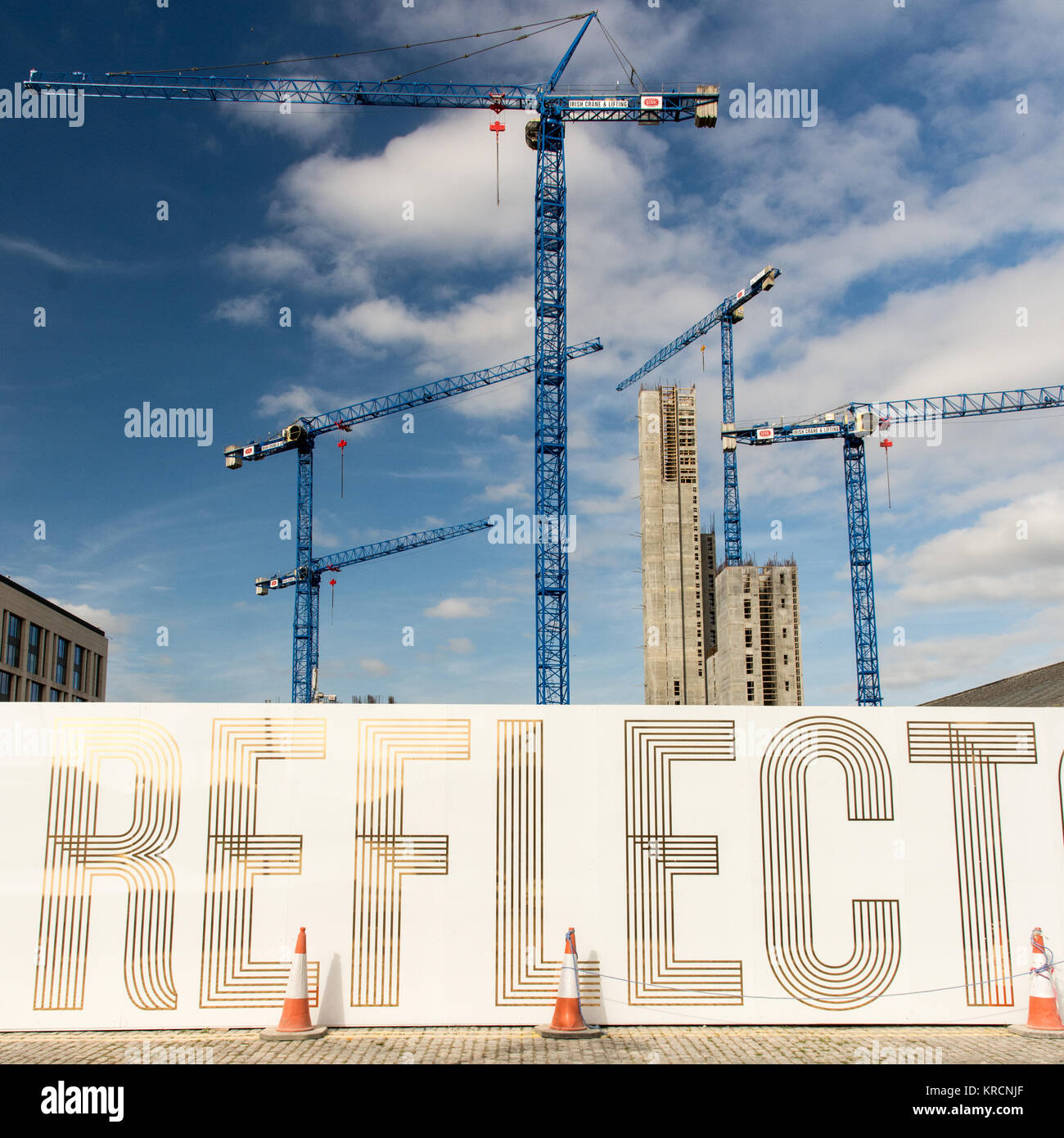 Dublin, Ireland - September 17, 2016: An array of tower cranes at a construction site in Dublin's regenerating - Stock Image