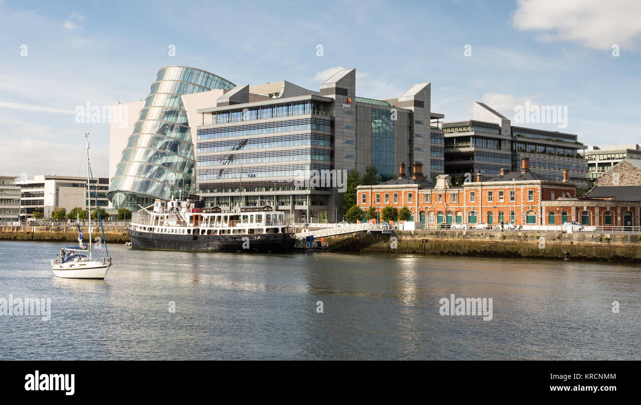 Dublin, Ireland - September 17, 2016: Convention Centre Dublin and the MV Cill Airne ship on the River Liffey in - Stock Image