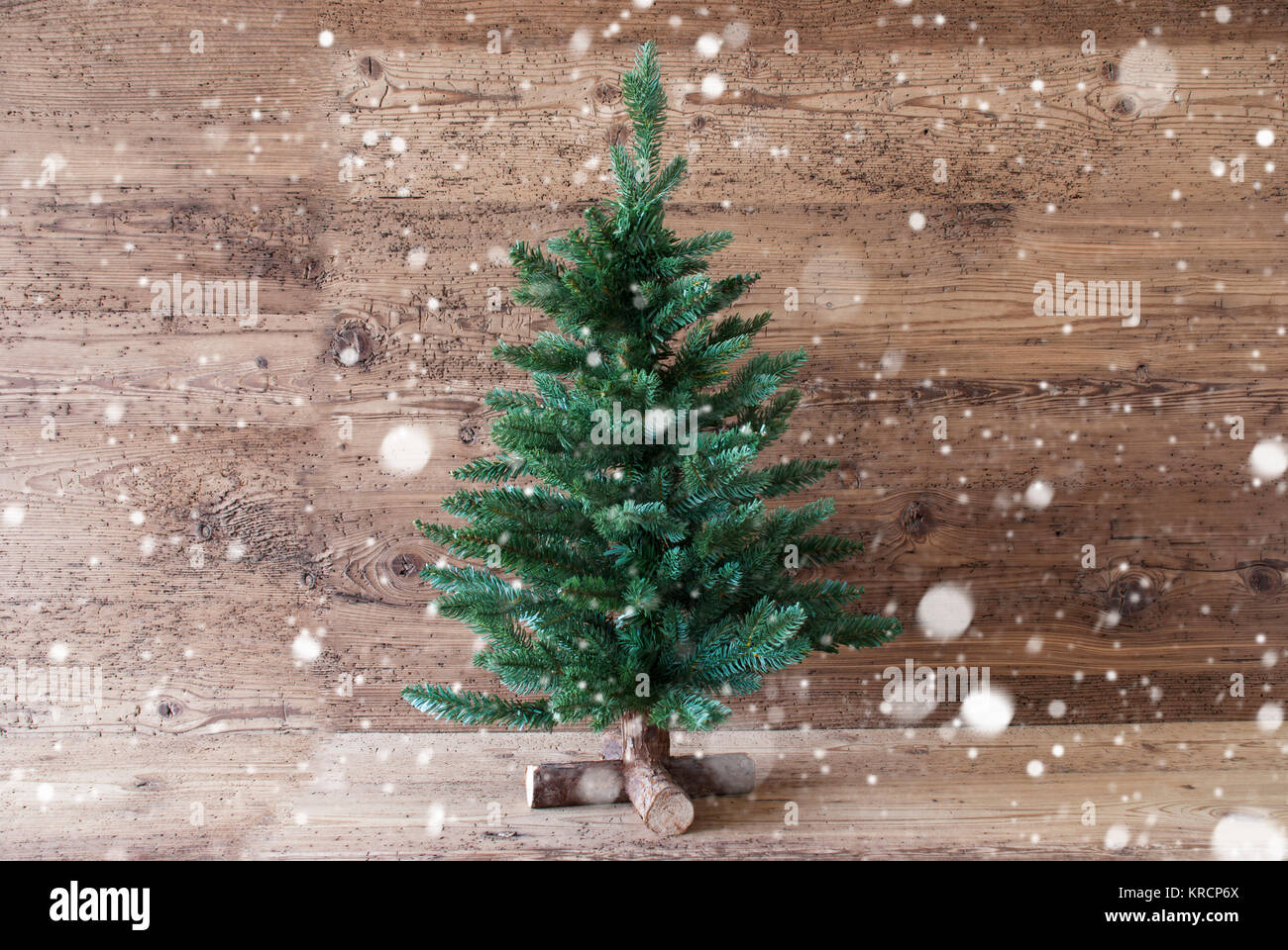 christmas tree,snowflakes,aged wooden background,copy space - Stock Image