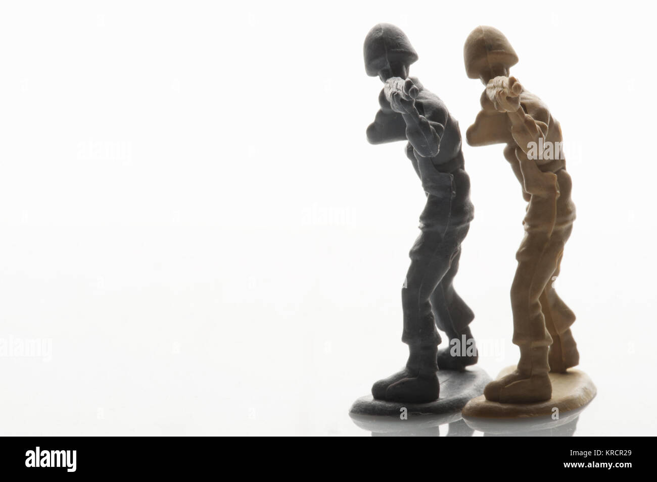 Toy soldiers play at war - Stock Image