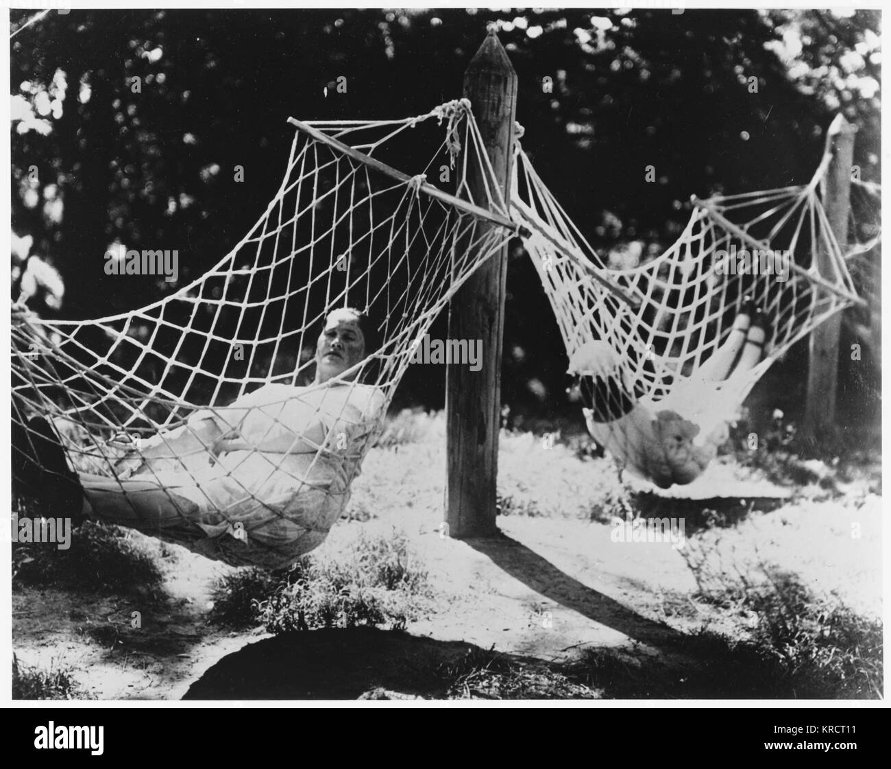A. Filipovva relaxes in a hammock in Gorky Park, Moscow Date: 1931 - Stock Image