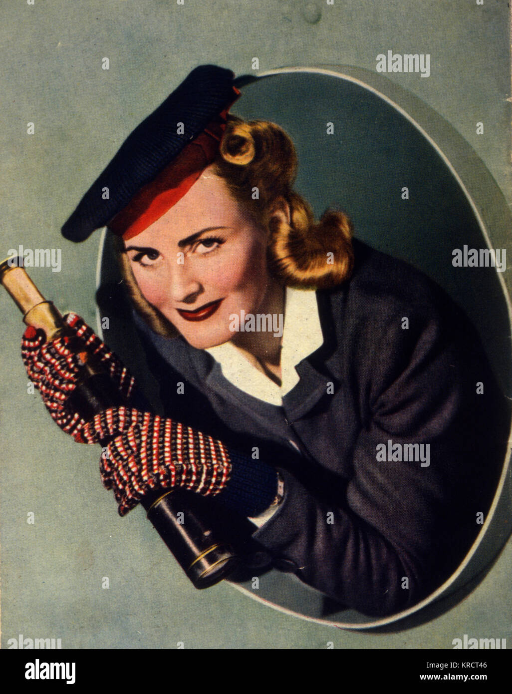 All the nice girls love a sailor especially this young woman whose decided to crochet herself a cap to let everyone - Stock Image