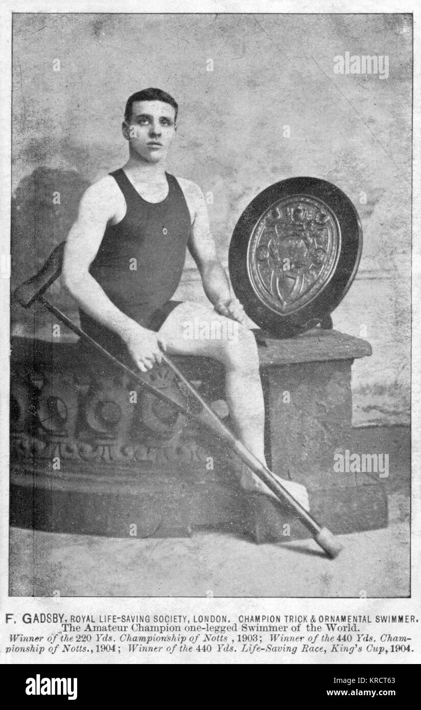 Mr F Gadsby, Nottingham Swimming Club; one-legged champion of the World, in swimming costume, holding a crutch. - Stock Image