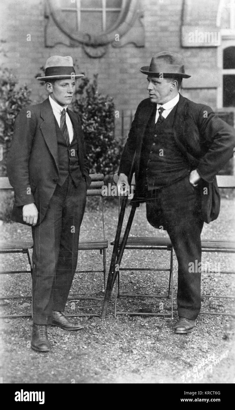Mr F Gadsby, Nottingham Swimming Club; former one-legged swimming champion of the World, photographed with his son. - Stock Image