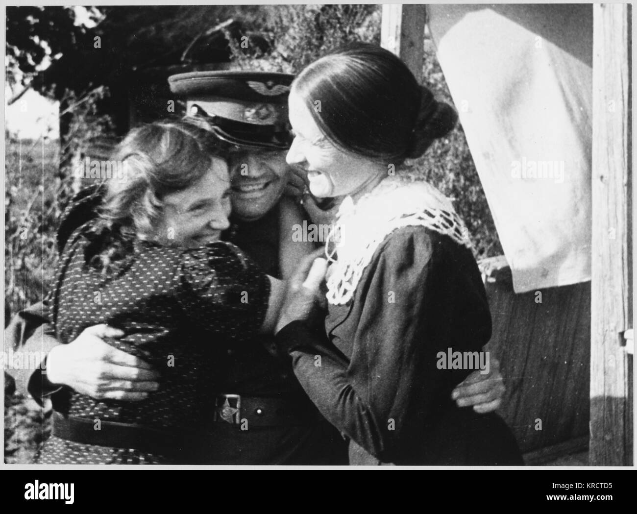 LIBERATION SCENES A Soviet soldier is greeted in a liberated village. Date: August 1943 - Stock Image