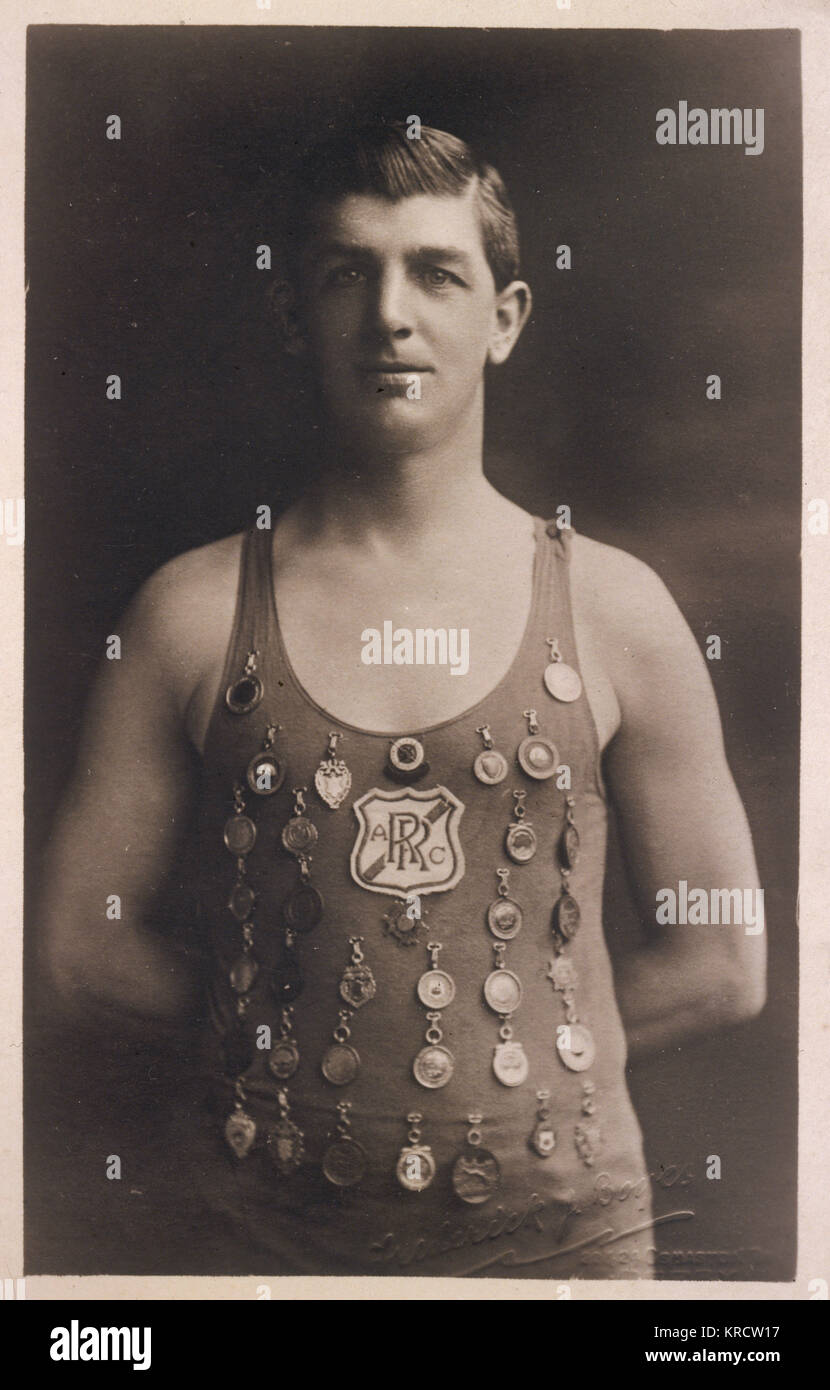 A swimming champion wearing a Rolls Royce Athletics Club badge and 35 medals on his costume. Date: 1910 - Stock Image