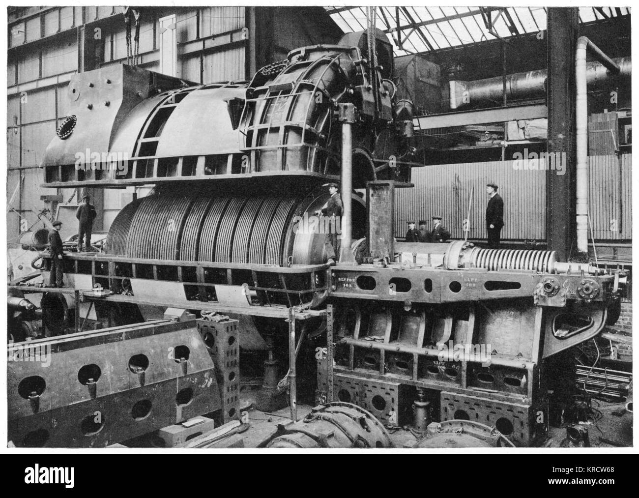 AQUITANIA' One of the engines of the Aquitania being lowered into position during its construction. Date: Launched - Stock Image