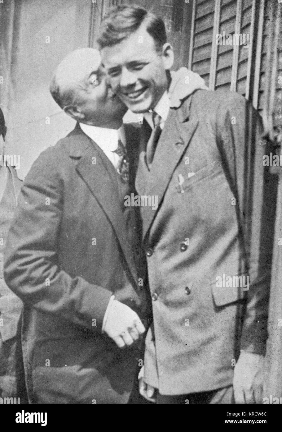 Lindbergh is greeted in Paris by French aviator Louis Bleriot (1872-1936) Date: 1927 - Stock Image