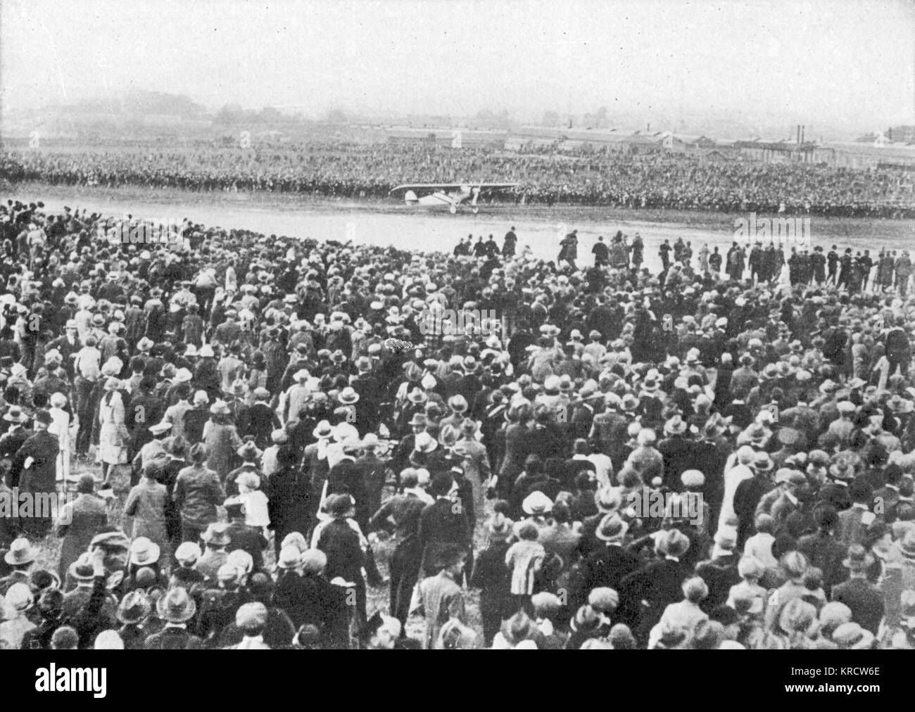 Thousands of people gather to welcome Charles Lindbergh and the 'Spirit of St. Louis' to Croydon, London. - Stock Image