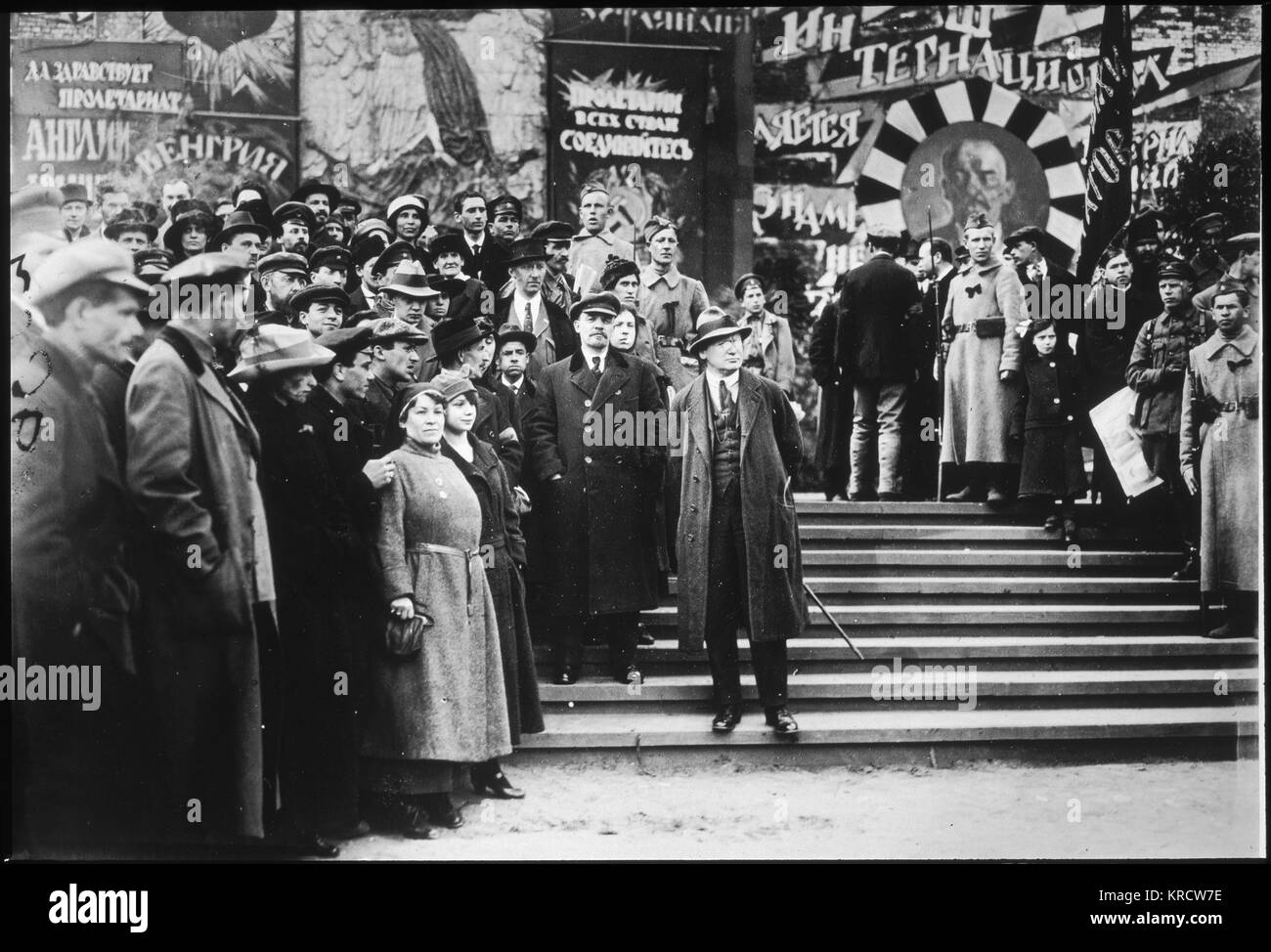 Lenin stands in front of the Kremlin for the May Day parade. Date: 1919 - Stock Image