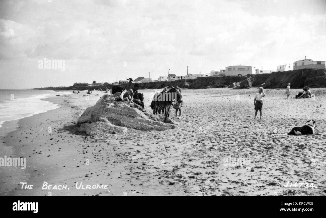 View of the beach at Ulrome, near Driffield, East Yorkshire, with a few holidaymakers. Date: 1940s - Stock Image