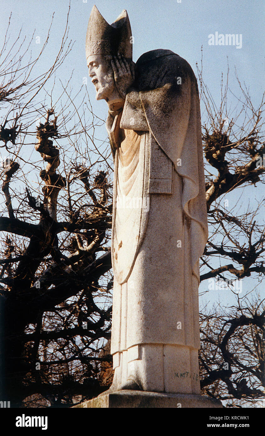 Statue of SAINT DENIS on the hill of Montmartre, Paris : though his head is removed from his body, he still carries - Stock Image